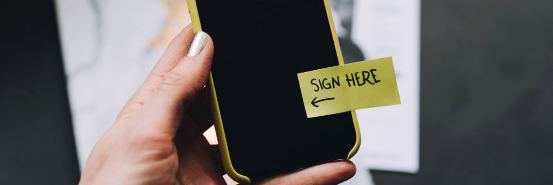 Sign here note on phone image by Kelly Sikkema on Unsplash